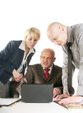 Three business people working at meeting Stock Photography