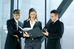 Three business people are working in an office Royalty Free Stock Images