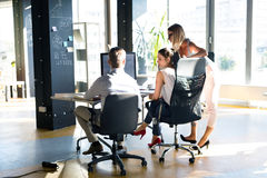 Three business people in the office talking together. Royalty Free Stock Photo