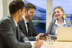 Three business peoples working together in meeting room Royalty Free Stock Photos