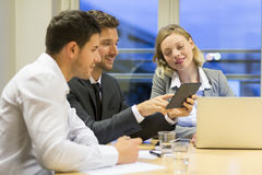 Three business peoples working together in meeting room Royalty Free Stock Photography