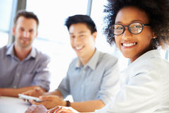 Three business professionals working together Stock Photography