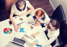 Three business woman investment consultant analyzing company annual financial report Stock Photo