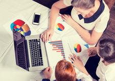 Three business woman investment consultant analyzing company annual financial report Stock Photography