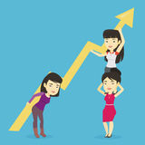 Three business women holding growth graph. Stock Photos