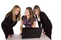 Three business women and laptop Royalty Free Stock Photos