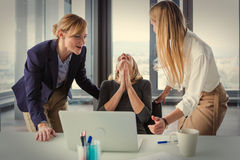 Three business women in modern office celebrating good project results Stock Photography