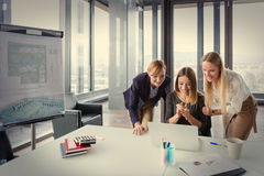 Three business women in modern office working on the project together Stock Image