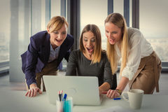 Three business women in modern office working on the project together Royalty Free Stock Photos