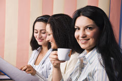 Three business women in office stock photos