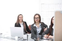 Three business women sitting at Desk in office.photo with copy space.  stock photography