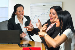 Three business women smiling. Royalty Free Stock Photo