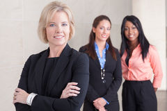 Three business women standing together Stock Photos