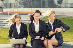 Three business women using technology stock photography