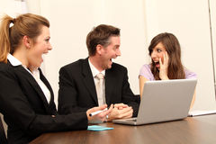 Three business workers sitting Royalty Free Stock Photo