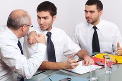 Three businessman argue over some documents Royalty Free Stock Photo