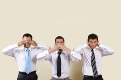 Three businessman covering eyes, mouth and ears Royalty Free Stock Photos