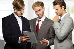 Three businessman discussing plans at office Stock Photo