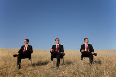 Three businessman at the field Royalty Free Stock Images