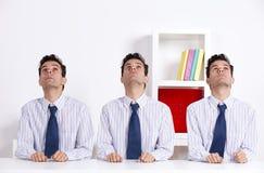 Three businessman looking up Stock Photo