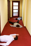 Three businessman lying down in office Royalty Free Stock Photography