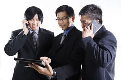 Three Businessman meeting and using mobile phone Stock Photos