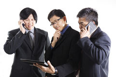 Three Businessman meeting and using mobilephone Royalty Free Stock Photos