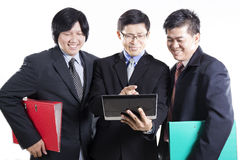 Three Businessman meeting and using Tablet Royalty Free Stock Image