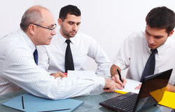 Three businessman sitting at table during meeting Stock Photography