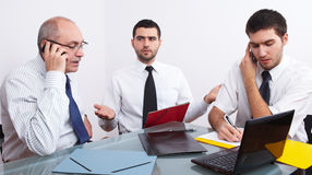 Three businessman sitting at table during meeting Royalty Free Stock Image