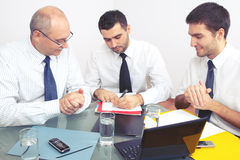 Three businessman sitting at table during meeting Royalty Free Stock Photography