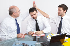 Three businessman sitting at table during meeting Royalty Free Stock Images