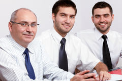 Three businessman sitting at table during meeting Royalty Free Stock Photo