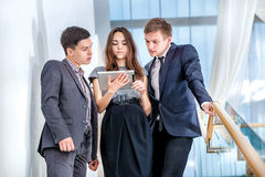 Three businessman standing on the stairs solve business problems Royalty Free Stock Photo
