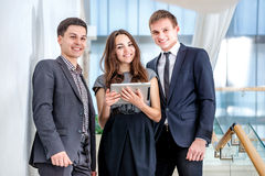 Three businessman standing on the stairs solve business problems Stock Photography