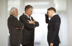 Three businessman are trying to come to an agreement Royalty Free Stock Photos