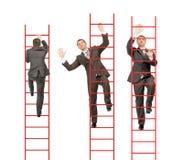 Three businessmen climbing stairs up Stock Photos