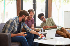 Three Businessmen Having Working Lunch In Office Royalty Free Stock Image