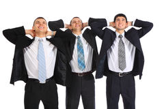 Three businessmen hold hands behind  head Royalty Free Stock Image