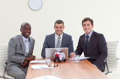 Three businessmen in a meeting smiling Royalty Free Stock Images