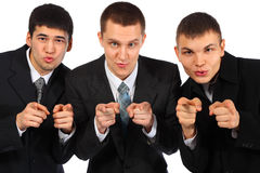 Three businessmen point fingers at you Stock Image