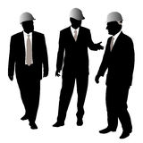 Three businessmen with protective helmet Stock Image