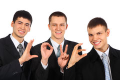 Three businessmen show  word love Royalty Free Stock Photography