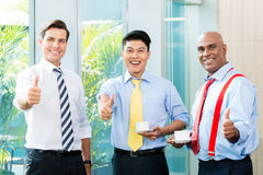 Three businessmen showing the thumbs up Royalty Free Stock Photos