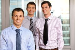 Three businessmen smiling Royalty Free Stock Image