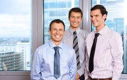 Three businessmen smiling Royalty Free Stock Photo