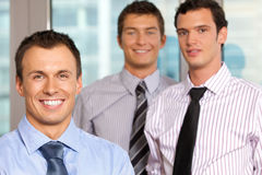 Three businessmen smiling at office, portrait Royalty Free Stock Image