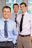 Three businessmen smiling at office, portrait Royalty Free Stock Photos