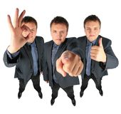 Three Businessmen, Two With Ok Gesture Stock Photo