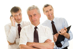 Three businessmen on a white Royalty Free Stock Photo